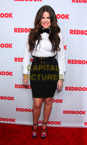 KHLOE KARDASHIAN ODOM .RedBook Celebrates First-Ever Family Issue With The Kardashians held at The Sunset Tower Hotel, West Hollywood, California, USA, April 11th 2011..full length belt waist skirt red pink strappy shoes sandals peep toe platform black bow tie white shirt .CAP/ADM/TC.©T. Conrad/AdMedia/Capital Pictures.
