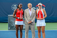 Washington, DC - August 3, 2019: Mark Ein presents Coco Gauff (USA) and Catherine McNally (USA) the trophies after the Women Doubles finals at William H.G. FitzGerald Tennis Center in Washington, DC  August 3, 2019.  (Photo by Elliott Brown/Media Images International)