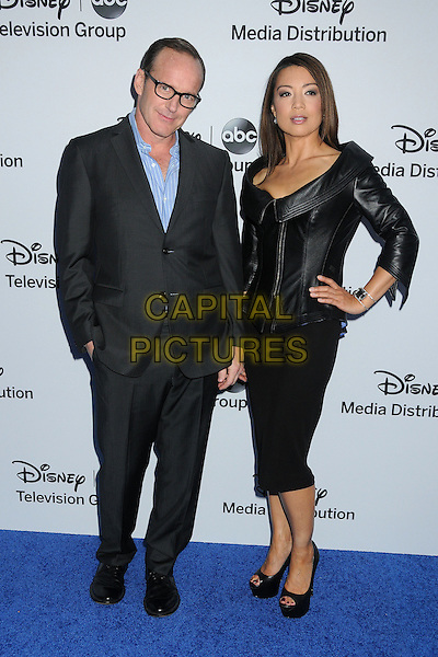 Clark Gregg, Ming-Na Wen.Disney Media Networks International Upfronts 2013 held at Walt Disney Studios, Burbank, California, USA..May 19th, 2013.full length dress leather jacket hand on hip black blue shirt glasses .CAP/ADM/BP.©Byron Purvis/AdMedia/Capital Pictures