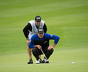 15.10.2014. The London Golf Club, Ash, England. The Volvo World Match Play Golf Championship.  Day 1 group stage matches.  Henrik Stenson [SWE] lines up a putt with his caddie.