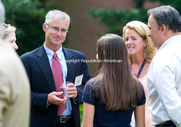 WATERTOWN, CT- 06 SEPT 06- 0906006JT02-<br /> Taft headmaster William MacMullen and his wife Pamela, greet new students at the school's campus on Wednesday during the welcomng of new students and monitors.<br /> Josalee Thrift Republican-American