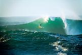 USA, Hawaii, surfer wipeout at Waimea Bay, The North Shore of Oahu