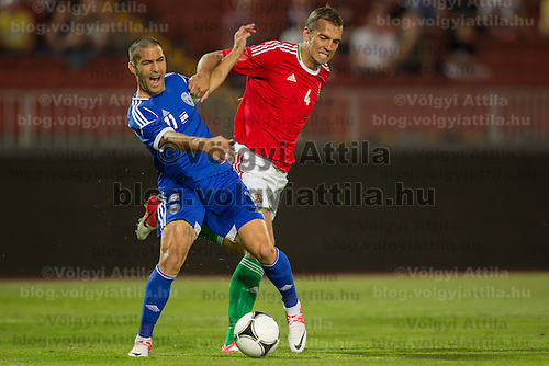Israel's Eitey Menachem Shechter (L) fights for the ball with Hungary's Roland Juhasz (R) during a friendly football match Hungary playing against Israel in Budapest, Hungary on August 15, 2012. ATTILA VOLGYI