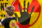 A boy in front of a anti nuclear symbol at an Anti Nuclear Rally held on the Dam Square in Amterdam, the Netherlands on April 16, 2011.