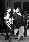 Ian Dury onstage with Joe Strummer of The Clash at the Palladium in NYC in 1980