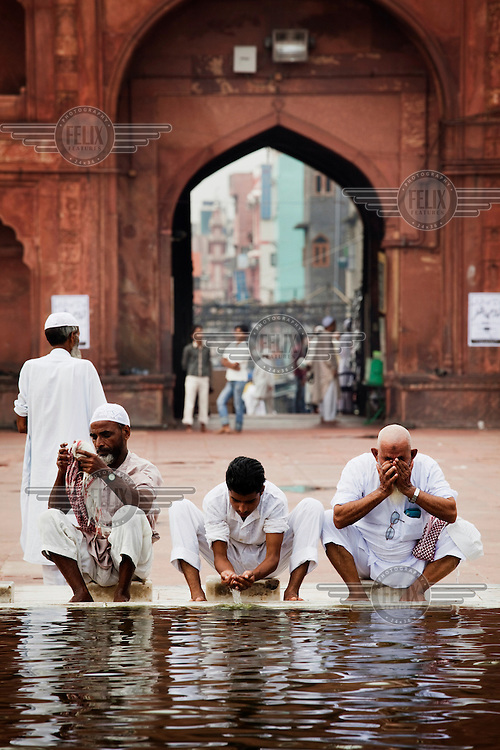 Men pray at the Jama Masjid, the largest mosque in the city.
