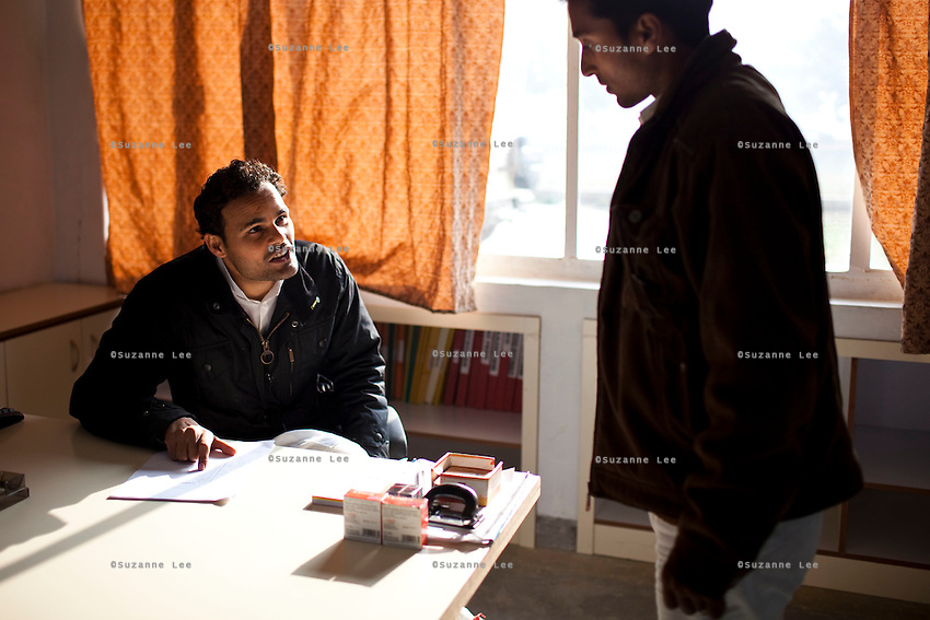 Minister of Legislative Assembly, Ritesh Pandey, 30, speaks to the sports teacher in Takshila Academy, a primary school he founded mid last year in Akbarpur, Ambedkar Nagar, Uttar Pradesh, India, on 21st January, 2012. Returning 1.5 years ago after almost 10 years abroad, Pandey is contesting on behalf of the Bahujan Samaj Party (BSP), a party that is based on its appeal to Dalit (the lowest Hindu caste) voters. Party leader Mayawati, herself a Dalit, has recently been giving out more tickets to muslims and high caste candidates in an attempt to woo a larger spectrum of voters in Uttar Pradesh, a Bellwether state. Photo by Suzanne Lee for The National (online byline: Photo by Szu for The National)