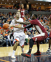 Virginia guard London Perrantes (23) is defended by Florida State guard Devon Bookert (1) during the second half of an NCAA basketball game Saturday Jan. 18, 2014 in Charlottesville, VA. Virginia defeated Florida State 78-66. (AP Photo/Andrew Shurtleff)