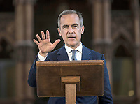18 July 2017 - Winchester, UK - The Governor of the Bank of England Mark Carney holds the New Ten Pound Note outside Winchester Cathedral where he unveiled the new design. The new note features Jane Austen on it who is buried in Winchester Cathedral, Hampshire. Photo Credit: Alpha Press/AdMedia