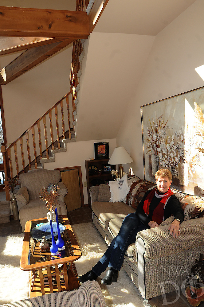 NWA Democrat-Gazette/FLIP PUTTHOFF <br /> Kathy Trotter enjoys the lake life      Wednesday Feb. 18 2014    at her home on Beaver Lake east of Lowell. Her living room, shown here, is one of her favorite places in the home.