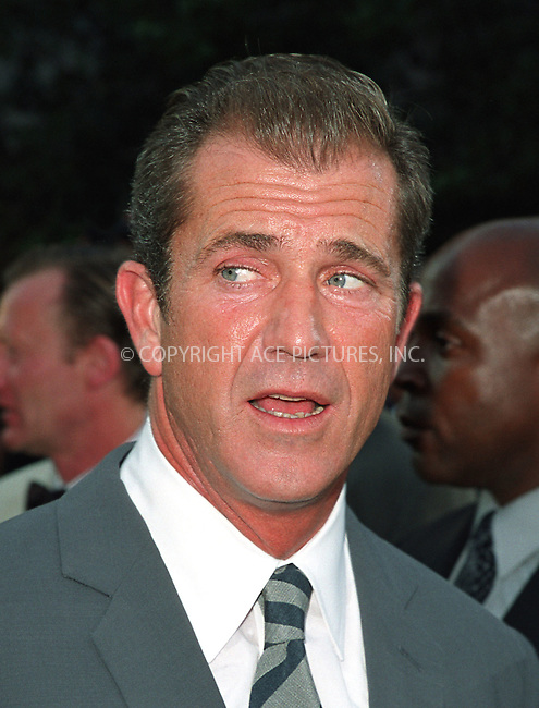 """Mel Gibson arrives at the world premiere of Touchstone Pictures' movie, """"Signs"""" at Lincoln Center, New York. July 29, 2002. Please byline: Alecsey Boldeskul/NY Photo Press.   ..*PAY-PER-USE*      ....NY Photo Press:  ..phone (646) 267-6913;   ..e-mail: info@nyphotopress.com"""