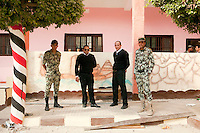 Egypt / Zagazig / 15.12.2012 / Police and army stand together posing for portrait in a polling station in Zagazig. People descended on polling stations across Egypt to vote on the highly controversial draft constitution, which has been a source of intense political protest in recent weeks. © Giulia Marchi