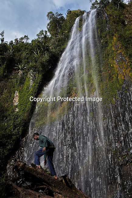 BONGA, ETHIOPIA:  Boys play next to Barta waterfall in a biosphere on December 4, 2012 outside Bonga, Ethiopia. This Kaffa region is known for its coffee production, wild coffee grown in high altitudes. This region is the original home of the coffee plant, coffee Arabica which grows in the forest of the highlands. The red berries are the main source of income in the area. Children and cattle also drink coffee. (Photo by: Per-Anders Pettersson)