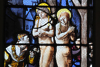 Saints Crispin and Crispinian, patron saints of cobblers, at Soissons, hanging by their armpits at the gallows, possibly with the governor Rictus Varus giving the order, from the Scenes of the Life and Martyrdom of Saints Crispin and Crispinian stained glass window, attributed to Nicolas le Prince, donated in 1530 by the cobblers guild in Gisors, in the Collegiate Church of Saint-Gervais-Saint-Protais, built 12th to 16th centuries in Gothic and Renaissance styles, in Gisors, Eure, Haute-Normandie, France. The church was consecrated in 1119 by Calixtus II but the nave was rebuilt from 1160 after a fire. The church was listed as a historic monument in 1840. Picture by Manuel Cohen