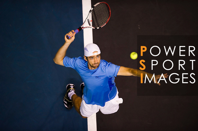 BANGKOK, THAILAND - OCTOBER 02:  Benjamin Becker of Germany serves against Jarkko Nieminen of Finland during the Day 8 of the PTT Thailand Open at Impact Arena on October 2, 2010 in Bangkok, Thailand. Photo by Victor Fraile / The Power of Sport Images