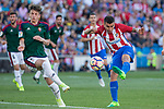 Miguel Olavide of Club Atletico Osasuna and Angel Correa of Atletico de Madrid during the match of La Liga between  Atletico de Madrid and Club Atletico Osasuna at Vicente Calderon  Stadium  in Madrid, Spain. April 15, 2017. (ALTERPHOTOS / Rodrigo Jimenez)