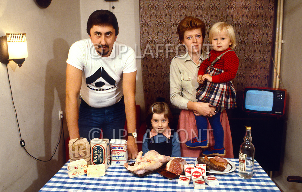 Poland, September, 1981 - A family of four in Warsaw poses with the entirety of what their food coupons can buy them on the legitimate market for a week. Because the government-allowed portions are so meager, many people turn to the black market to fill their stomachs.<br /> Pologne, septembre 1981 &ndash; A Varsovie, une famille de 4 personnes montrent sur la table ce qui leur est permit d&rsquo;acqu&eacute;rir avec les tickets de rationnement pour une semaine. Toutefois, m&ecirc;me en ayant ces bons de ravitaillement il y a des semaine o&ugrave; ils ne trouvent pas tout.