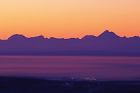 Alaska mountain range horizon, Mt. Hayes, viewed looking south over ice fog covering the city of Fairbanks, january, winter, Tanana valley flats, Fairbanks, Alaska