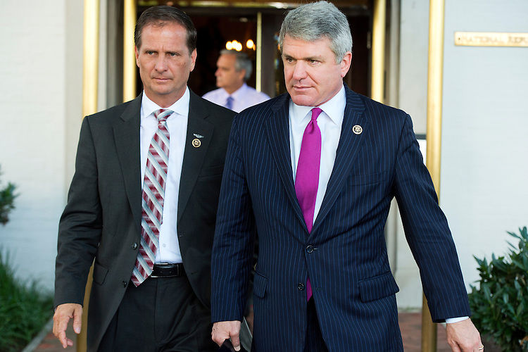 UNITED STATES - JUNE 16: Reps. Michael McCaul, R-Texas, right, and Chris Stewart, R-Utah, leave a meeting of House Republicans at the RNC, June 16, 2014. (Photo By Tom Williams/CQ Roll Call)