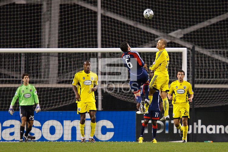 25 OCTOBER 2009:  Shalrie Joseph of the New England Revolution (21) heads the ball on Kenny Schoeni of the Columbus Crew (25)during the New England Revolution at Columbus Crew MLS game in Columbus, Ohio on October 25, 2009.