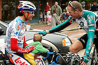 Gord Fraser (right), of Health Net Presented by Maxxis, greets Fred Rodriguez, of Davitamon-Lotto, and Rodriguez's eight-month-old son, Aidan, before the start of Stage 4 of the Ford Tour de Georgia.  Rodriguez won the 118.9-mile (191.4-km) stage from Dalton to Dahlonega.<br />