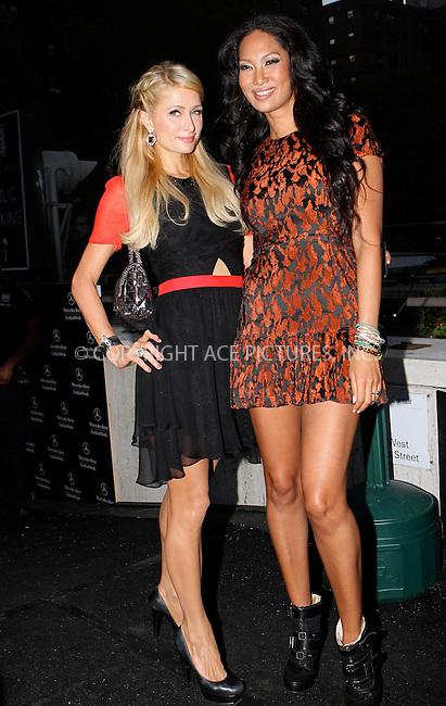 WWW.ACEPIXS.COM....September 7 2012, New York City....Paris Hilton and Kimora Lee Simmons at Spring 2013 Mercedes-Benz Fashion Week on September 7, 2012 in New York City.....By Line: Nancy Rivera/ACE Pictures......ACE Pictures, Inc...tel: 646 769 0430..Email: info@acepixs.com..www.acepixs.com
