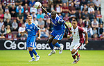 Hearts v St Johnstone...14.08.10  .Cleveland Taylor gets to the ball ahead of Suso Santana.Picture by Graeme Hart..Copyright Perthshire Picture Agency.Tel: 01738 623350  Mobile: 07990 594431