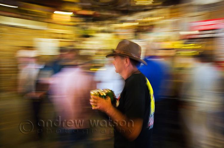 Dinkers inside the Birdsville Hotel during the annual Birdsville races.  Birdsville, Queensland, Australia