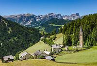 Italy, South Tyrol (Trentino - Alto Adige), La Valle: hamlet Tolpei with steeple of parish church St Genesius in Old-Wengen (right), the chapel Saint Barbara (middle), at background Puez-Geisler-Group at Puez-Geisler Nature Park (Parco naturale Puez Odle) | Italien, Suedtirol (Trentino - Alto Adige), Wengen: der Weiler Tolpei mit dem Turm der alten Pfarrkirche St. Genesius in Altwengen (rechts) und links die spaetgotische Barbarakapelle, im Hintergrund die Puez-Geisler-Gruppe im Naturpark Puez-Geisler