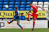 Fleetwood Town's Ashley Eastham clears the danger away from Peterborough United's Andrea Borg<br /> <br /> Photographer David Shipman/CameraSport<br /> <br /> The EFL Sky Bet League One - Peterborough United v Fleetwood Town - Friday 14th April 2016 - ABAX Stadium  - Peterborough<br /> <br /> World Copyright &copy; 2017 CameraSport. All rights reserved. 43 Linden Ave. Countesthorpe. Leicester. England. LE8 5PG - Tel: +44 (0) 116 277 4147 - admin@camerasport.com - www.camerasport.com