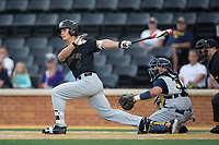 Stuart Fairchild (4) of the Wake Forest Demon Deacons follows through on his swing against the West Virginia Mountaineers in Game Six of the Winston-Salem Regional in the 2017 College World Series at David F. Couch Ballpark on June 4, 2017 in Winston-Salem, North Carolina.  The Demon Deacons defeated the Mountaineers 12-8.  (Brian Westerholt/Four Seam Images)
