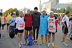 Denis Brogniart, French host of French reality television show Survivor, poses with members of the TF1 team in the first corral on Columbus Drive just before the start of the Chicago Marathon in Chicago, Illinois on October 11, 2009.