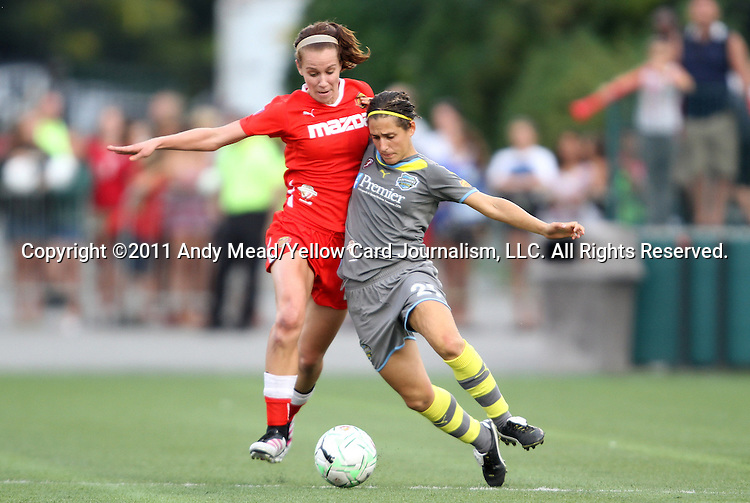 27 August 2011: Western New York's Beverly Goebel (left) earns a second yellow card and subsequent red card ejection for this foul on Philadelphia's Veronica Boquete (ESP) (right). Western New York Flash defeated the Philadelphia Independence 5-4 on penalty kicks to win the final after the game ended in a 1-1 tie after overtime at Sahlen's Stadium in Rochester, New York in the Women's Professional Soccer championship game.