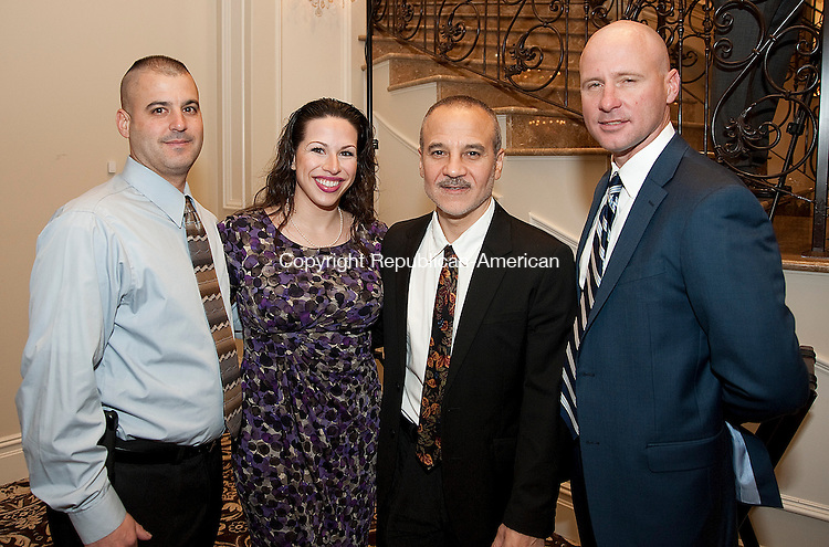 PROSPECT- 111413JS09- Kevin Carabetta of Meriden; Sarah Elizabeth DiMeo, President of the Board of Directors for Main Street Waterbury; Joshua Angelus, President of the Waterbury Neighborhood Council and Jim O'Rourke, Executive Director of the Greater Waterbury YMCA, at the Waterbury Neighborhood Council Awards dinner at Aria Wedding and Banquet Facility in Prospect. Main Street Waterbury was honored with City Service Award for Arts and Culture during the event while the YMCA was awarded with the City Service Award for Organization of the Year. <br /> Jim Shannon Republican-American