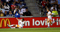 Houston Dynamo midfielder Stuart Holden (22) celebrates after scoring the game's first goal, while defender Wade Barrett (24) runs over to congratulate him. The Houston Dynamo defeated the Chicago Fire 4-0 at Toyota Park in Bridgeview, IL on July 12, 2007.