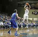 SIOUX FALLS, SD - NOVEMBER 30:  Skyler Flatten #1 from South Dakota State University spots up for a jumper over Brett Comer #0 from Florida Gulf Coast in the second half of their game Sunday afternoon at the Sanford Pentagon in Sioux Falls. (Photo by Dave Eggen/inertia)