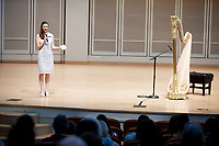 USA International Harp Competition Executive Director Erin Brooker-Miller makes an announcement before a laureate recital by harpist Lenka Petrovic during the 11th USA International Harp Competition at Indiana University in Bloomington, Indiana on Sunday, July 7, 2019. (Photo by James Brosher)