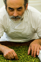 Portrait of confectioner Corrado Assenza selecting Bronte pistachios for whom he is the ambassador