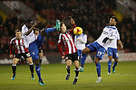 high challenged by Leon Barnett of Bury on Stefan Scougall of Sheffield United during the English Football League One match at Bramall Lane, Sheffield. Picture date: November 22nd, 2016. Pic Jamie Tyerman/Sportimage