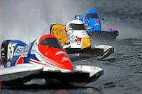 Mark Welch (#95) is flacked by Ruben Ascencio III (#65) and Jose Mendana, Jr. (#21)  (Formula 1/F1/Champ class)
