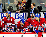 10 April 2010: Montreal Canadiens' Head Coach Jacques Martin looks out from behind the bench during the last game of the regular season against the Toronto Maple Leafs at the Bell Centre in Montreal, Quebec, Canada. The Leafs defeated the Habs 4-3 in sudden death overtime as the Canadiens advance to the Stanley Cup Playoffs with the single point. Mandatory Credit: Ed Wolfstein Photo