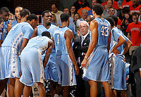 North Carolina head coach Roy Williams talks with his team during the game against Virginia at the John Paul Jones arena in Charlottesville, Va. Virginia defeated North Carolina 61-52.