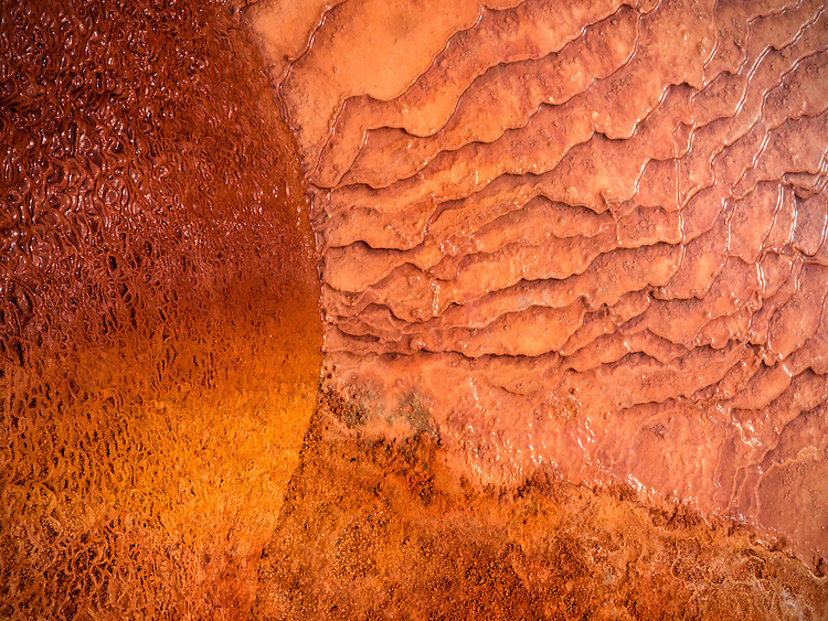 Abstract sun-like pattern in the travertine at Crystal Geyser along the Green River in southern Utah, USA.