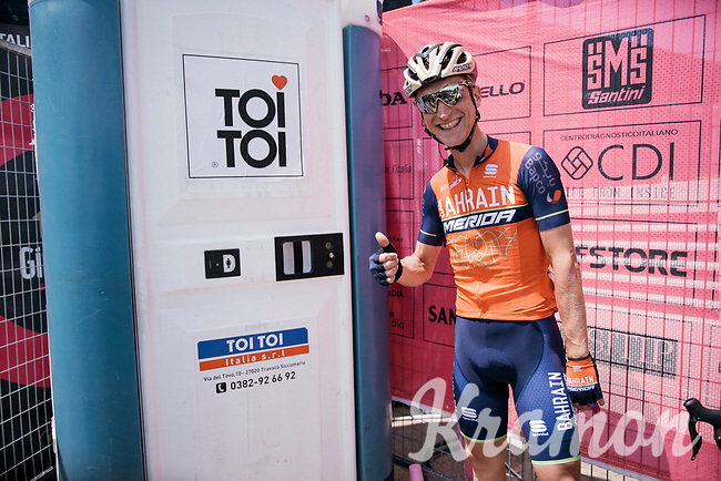 Enrico Gasparotto (ITA/Bahrain Merida) having some fun cueing at the lavatory unit at the stage start in the tiny birth town of Fausto Coppi: Castellania<br /> <br /> 100th Giro d'Italia 2017<br /> Stage 14: Castellania › Oropa (131km)