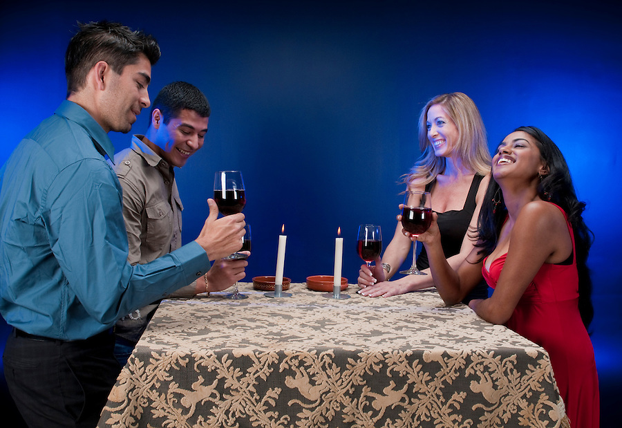 Group of friends drinking wine and having fun.