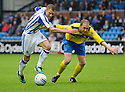 KILMARNOCK'S DEAN SHIELS IS HELD BACK BY ST JOHNSTONE'S STEVEN ANDERSON