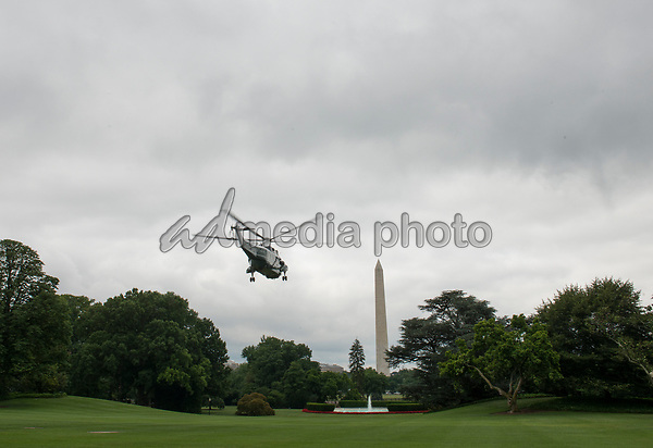 Marine One carrying United States President Donald J. Trump, first lady Melania and their son Barron, departs the White House Camp David, the Presidential retreat near Thurmont, Maryland, in Washington, DC, USA, 17 June 2017. Photo Credit: Michael Reynolds/CNP/AdMedia