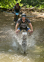 NWA Democrat-Gazette/BEN GOFF @NWABENGOFF<br /> Stu Power, a category 3 racer from Fayetteville, fords a creek Sunday, July 16, 2017, during cross country races on the final day of the 19th annual Fat Tire Festival at Lake Leatherwood City Park in Eureka Springs.