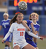Olivia Dooley #10 of Manhasset, left, and Allison Trebold #19 of Calhoun jockey for position on a header during a Nassau County Conference AB1 varsity girls soccer game at Calhoun High School on Tuesday, Oct. 16, 2018. The match, which was called with 9:57 remaining due to darkness, ended in a 1-1 tie.
