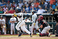 Michigan Wolverines second baseman Ako Thomas (4) follows through on his swing during Game 1 of the NCAA College World Series against the Texas Tech Red Raiders on June 15, 2019 at TD Ameritrade Park in Omaha, Nebraska. Michigan defeated Texas Tech 5-3. (Andrew Woolley/Four Seam Images)